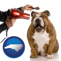 north-carolina map icon and a dog being groomed with a comb and a hair dryer